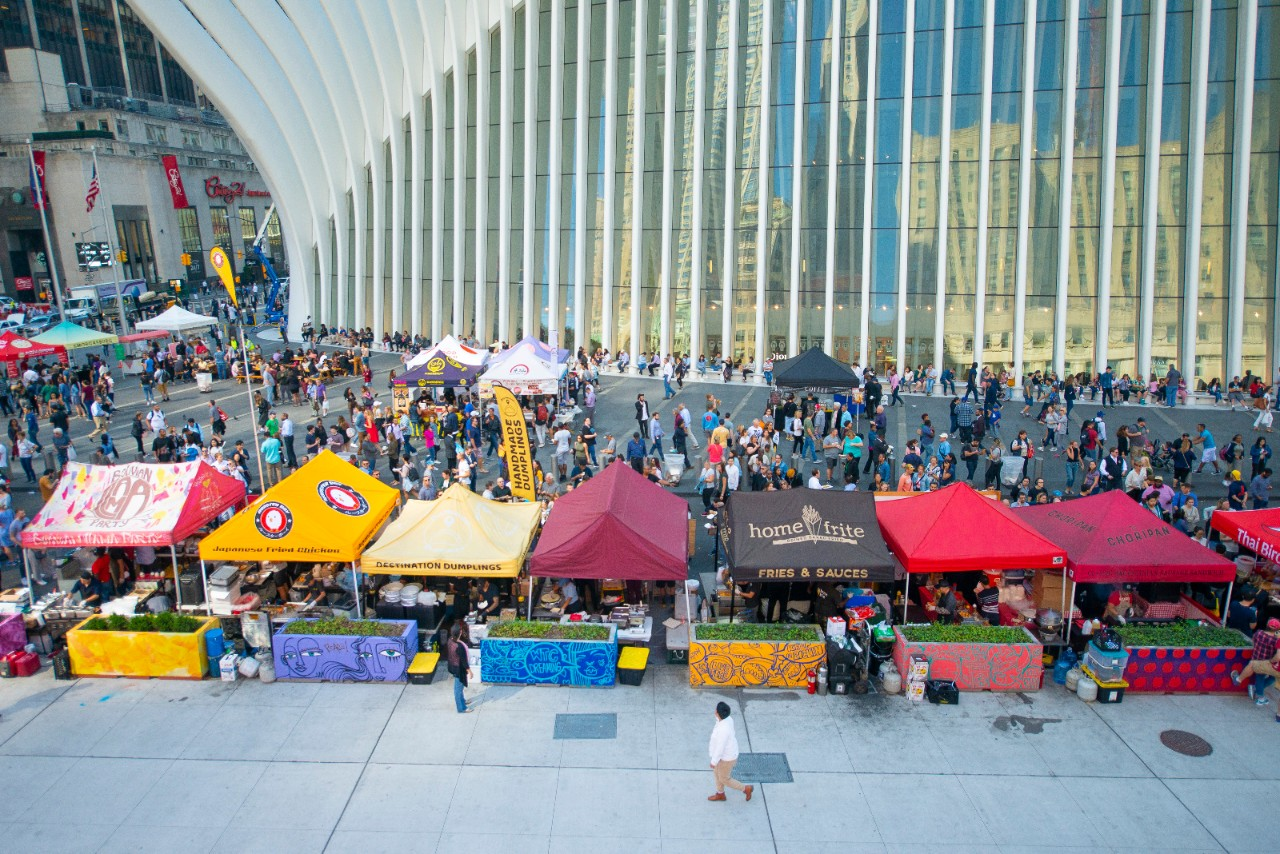 Vendors and visitors gather outside the Oculus for the weekly Smorgasburg food market.